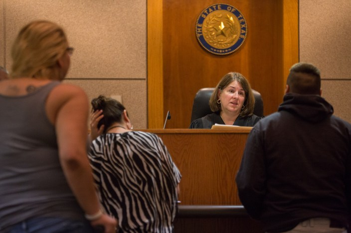 Judge Laura Parker informs a Crossroads participant that she is being detained and will be receive a GPS tracking device. Photo by Scott Ball.