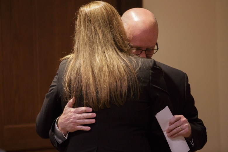 Kevin Wolff embraces his wife Sandi Wolff following a press conference confronting the events of a DWI charge. Photo by Scott Ball.