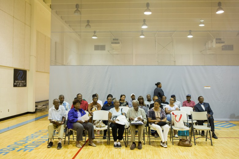 Community members gather at the Eastside Boys and Girls Club off of Martin Luther King Jr. Drive. Photo by Scott Ball.