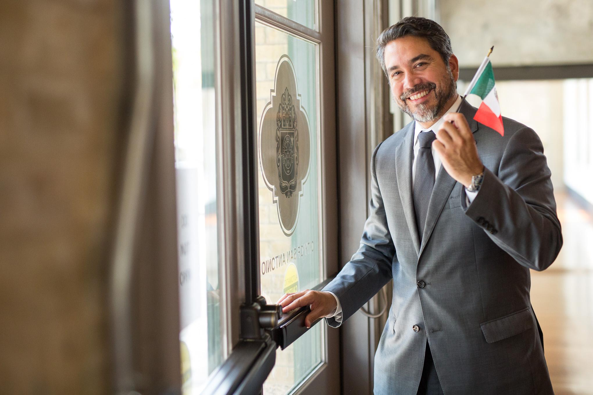 Councilman Roberto Treviño (D1) waves a miniature Mexican Flag following the public announcement. Photo by Scott Ball.