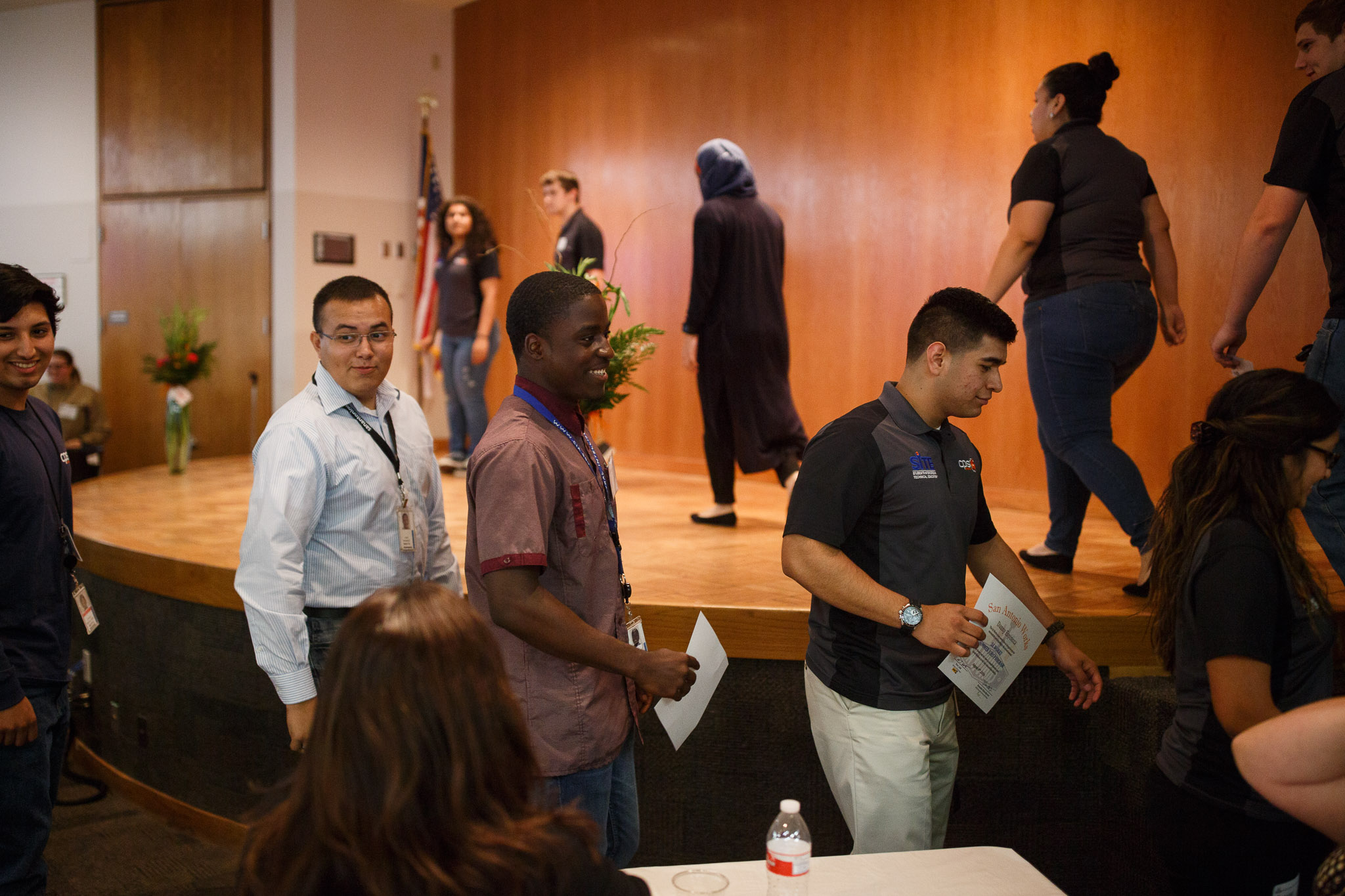 CPS Energy summer interns file in a line heading onstage to be congratulated. Photo by Scott Ball.