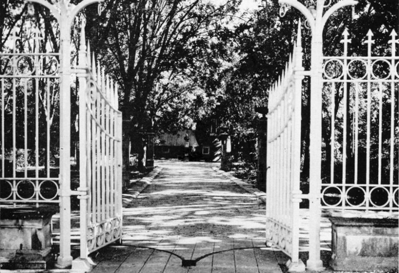 The view through the Hildebrand gate, circa 1940, shows this entrance once had a forested drive. At the end of the drive was a bust of Porfirio Díaz and the tower building. Photo courtesy of Urrutia Photo Collection.