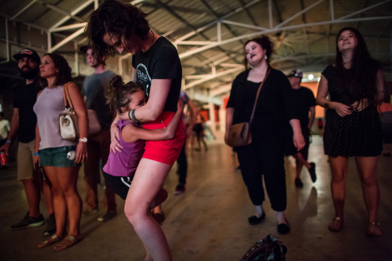 Ilima Jaceldo, 6, dances with her mother during Mission Pachanga. Photo by Michael Cirlos.