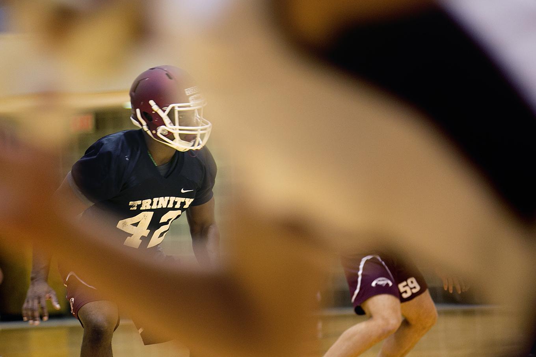 Trinity linebacker Julian Turner prepares for a drill at practice. Photo by Kathryn Boyd-Batstone.