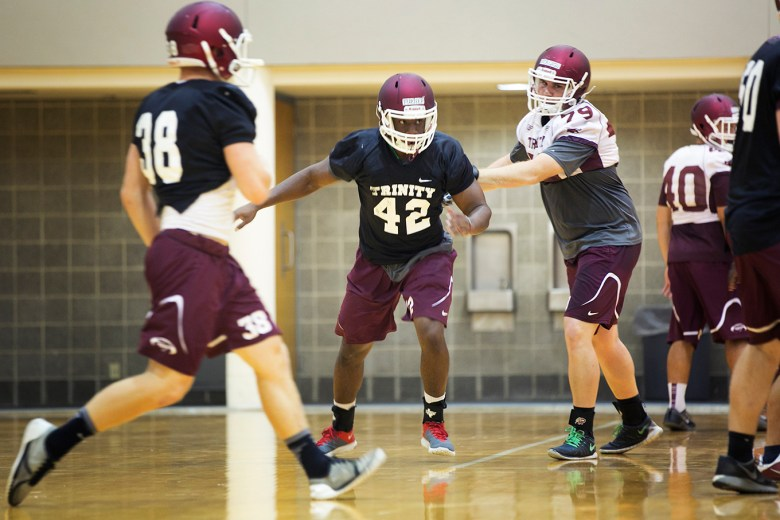 Trinity linebacker Julian Turner completes a practice drill during a rained out practice. Photo by Kathryn Boyd-Batstone.
