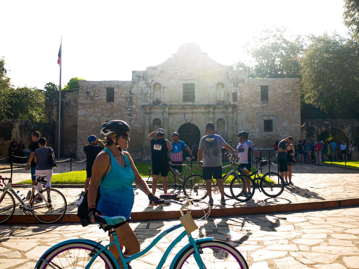 Bikers make their first stop of the World Heritage Festival Bike Ride/Tour at The Alamo. Photo by Kathryn Boyd-Batstone.