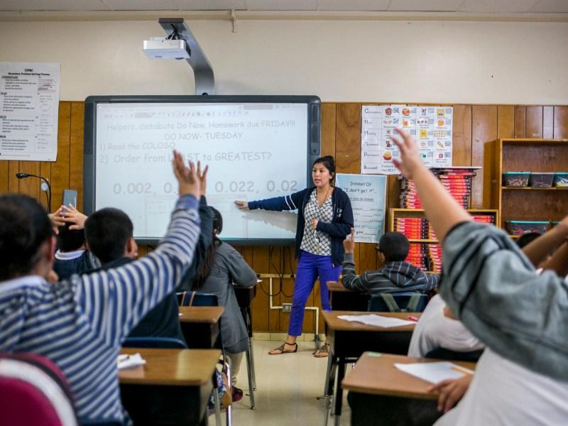 A teacher at Tafolla Middle School uses a smart board to teach a math lesson. Photo by Kathryn Boyd-Batstone.