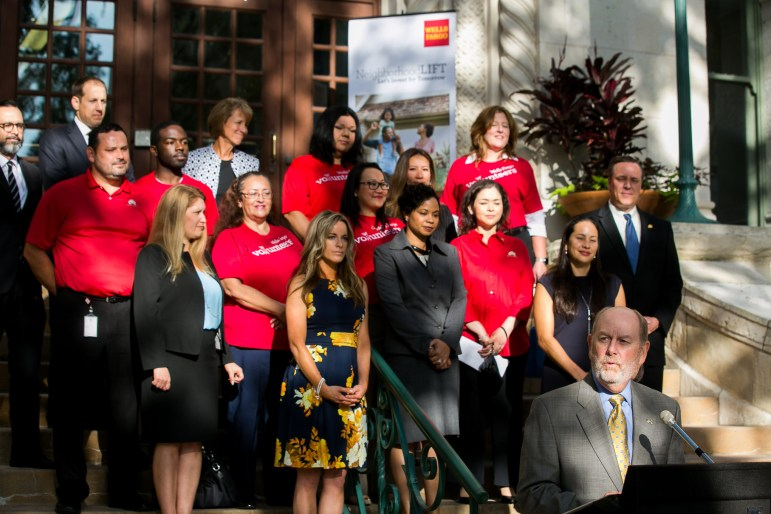 Steve Arnold, Wells Fargo South Central Texas area president, announces the grant recipients on the steps of City Hall. Photo by Kathryn Boyd-Batstone.