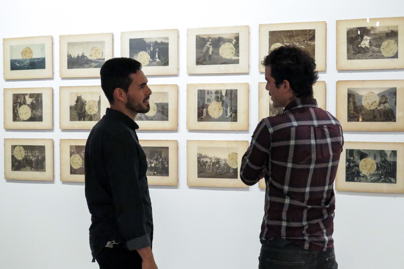 Local artists Jose Sotela and Ernesto Ibanez reflect on the artwork displayed at Centro de Artes. Photo by Rocío Guenther.