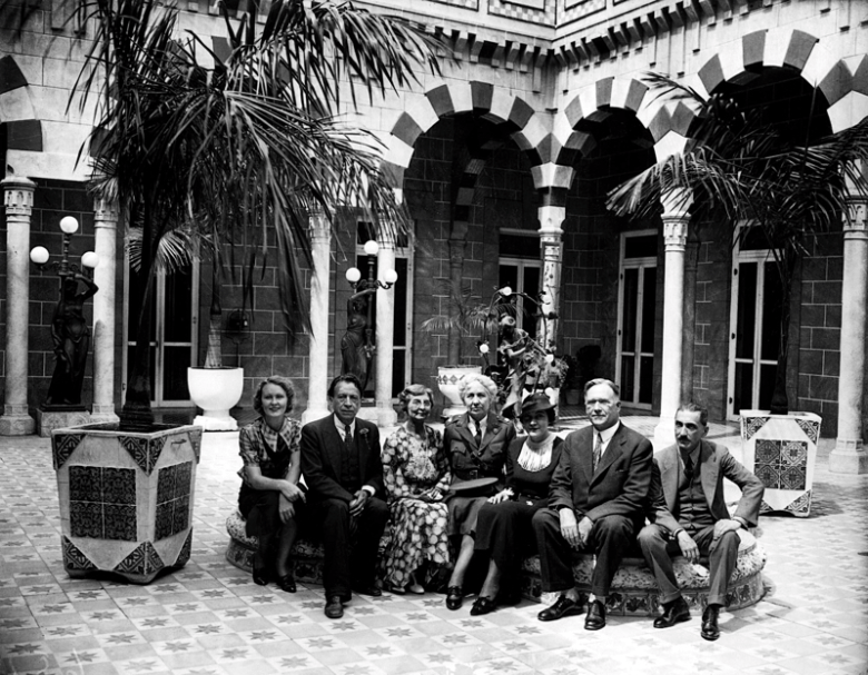 Doctor Urrutia with friends in the courtyard of his Broadway home. Photo courtesy of Urrutia Photo Collection.