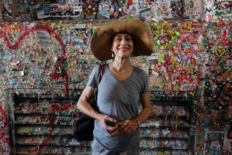 Monika Maeckle behind the gum wall near Pike Place Market in Seattle. Photo by Robert Rivard.