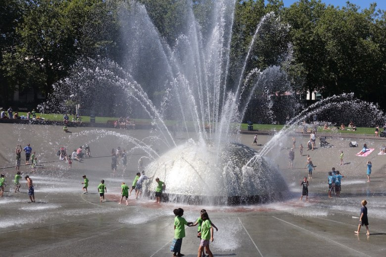 Children frolic in a Seattle park fountain. Photo by Robert Rivard.