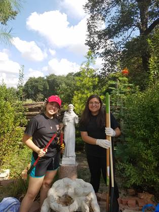 UIW students Mariana Rodriguez and Melissa Rodriguez continue the spirit of service helping at Mission Concepción. Photo courtesy of the Sisters of Charity of the Incarnate Word.