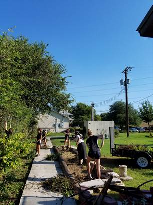 UIW students from the Synchronized Swimming Team landscaping around the Food Pantry run by the Pax Christi Sisters. Photo courtesy of the Sisters of Charity of the Incarnate Word.