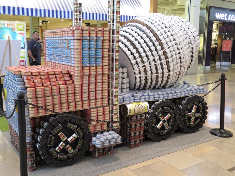 """RVK Architects, Spectrum Lighting, and Lundy and Franke Engineering Inc's entry for the 11th annual Canstruction, """"Paving Our Way Out of Hunger"""". Photo by James McCandless"""