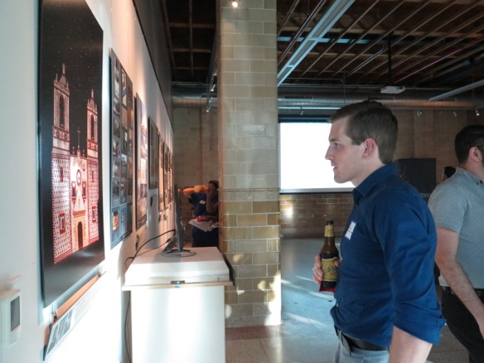 Designer Ryan Bloom observes an exhibit piece inspired by the San Antonio Missions. Photo by Rocío Guenther.