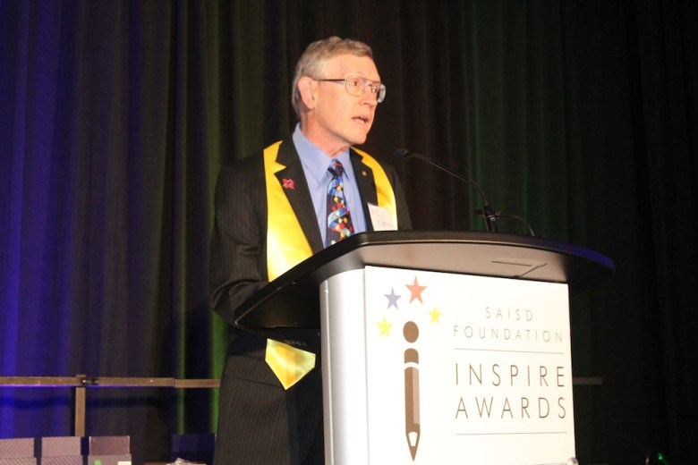 Nobel Prize in Chemistry recipient William Esco Moerner speaks about his educational and professional career after receiving the SAISD Foundation's Inspire Award for Excellence. Image courtesy of John Lawler, SAISD videographer.
