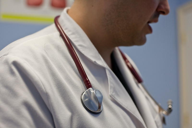 A physician wears a stethoscope around his neck. Photo by Callie Richmond for The Texas Tribune.