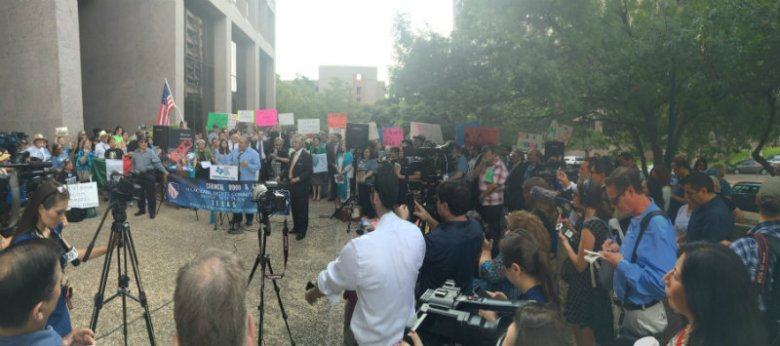 Officials speak during a press conference outside the William B. Travis building in Austin. Photo by Leo Treviño.