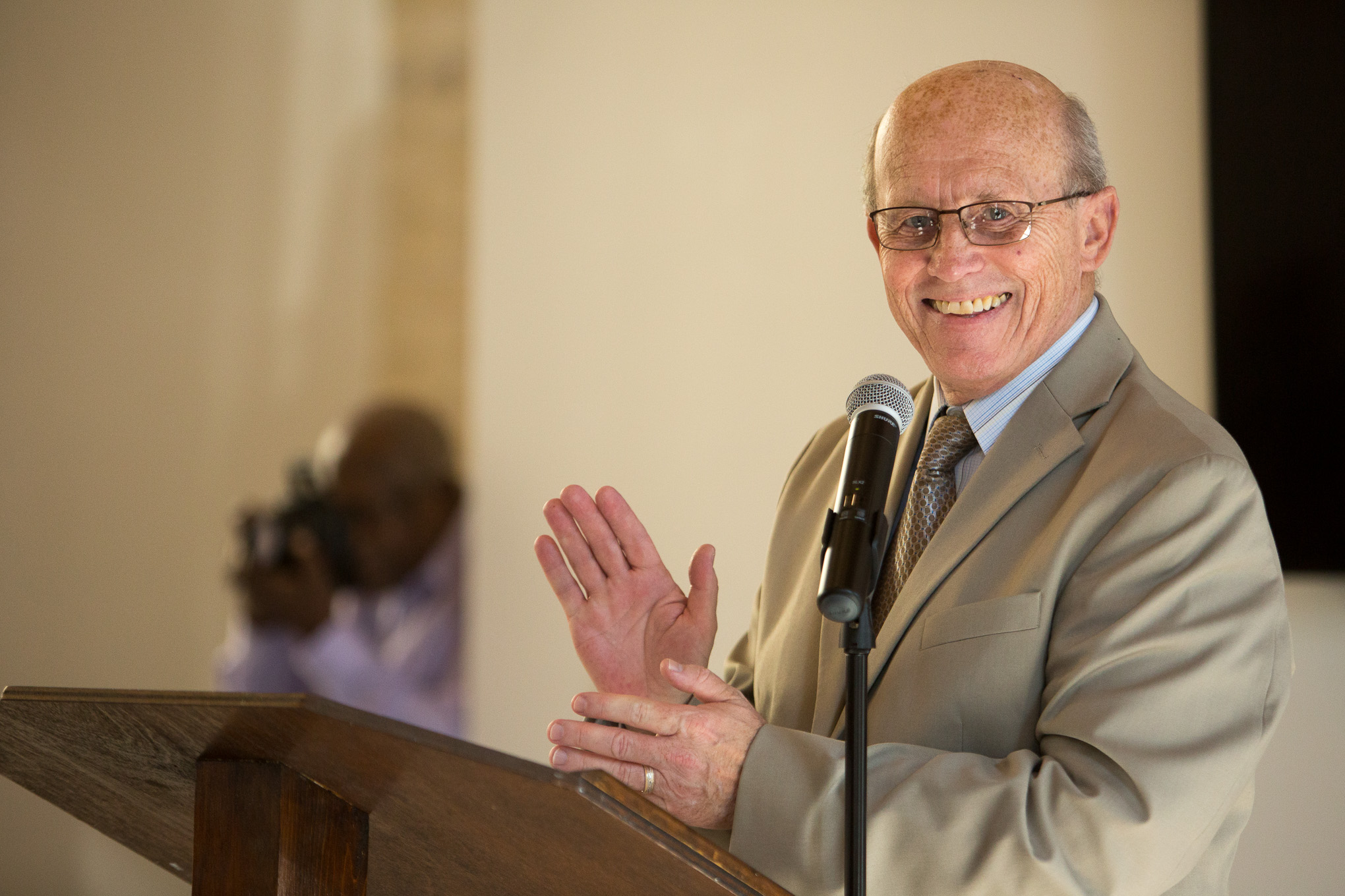 Executive Director of the Healy-Murphy Center Douglas Watson applauds during the ceremony of The Center for Family and Community Engagement. Photo by Scott Ball.