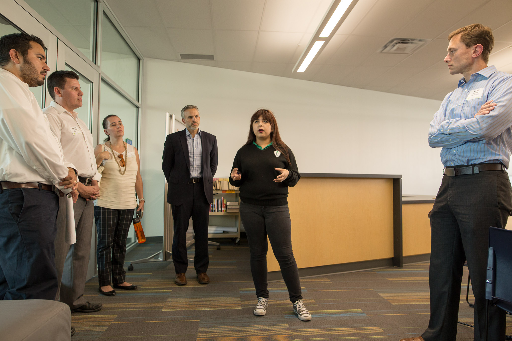 High School student Arlene Serna discusses the library work study room. Photo by Scott Ball.