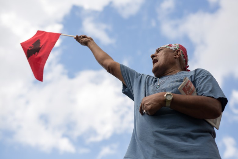 Lupe Salgado waves a United Farm Workers flag at Milam Park. Photo by Scott Ball.