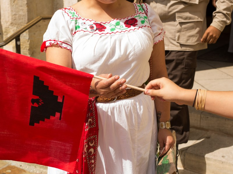 United Farm Workers flags are handed out to attendees following Mass at San Fernando Cathedral. Photo by Scott Ball.