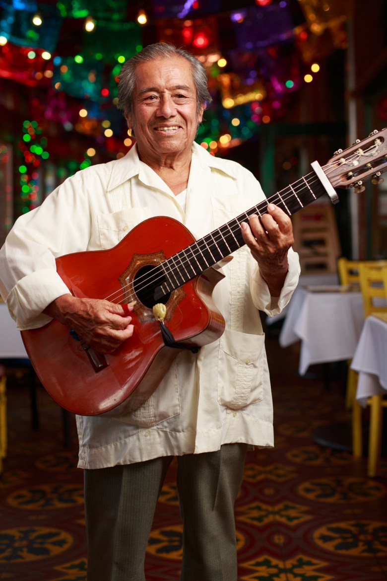 Tony Garcia has played at Mi Tierra for 43 years. Photo by Scott Ball.