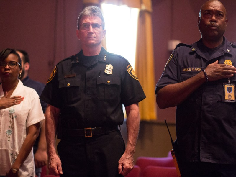 (right to left) SAFD Chief Charles Hood, SAPD Chief William McManus, and Mayor Ivy Taylor stand during the National Anthem. Photo by Scott Ball.