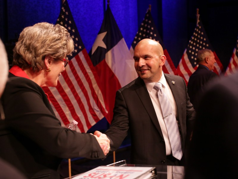 Sheriff Susan Pamerleau and her defendant Javier Salazar shake hands following the debate. Photo by Scott Ball.