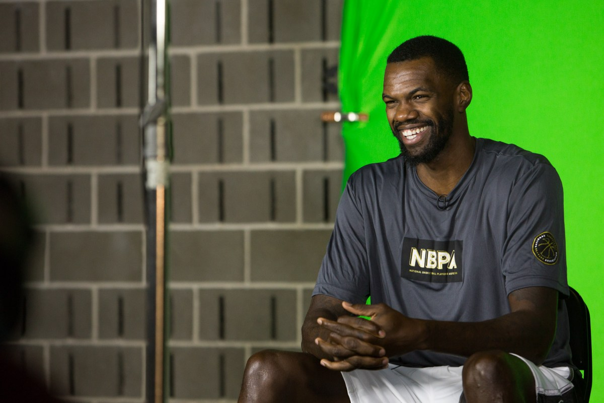 Newly instated Spur Dewayne Dedmon sits for an interview during media day. Photo by Scott Ball.