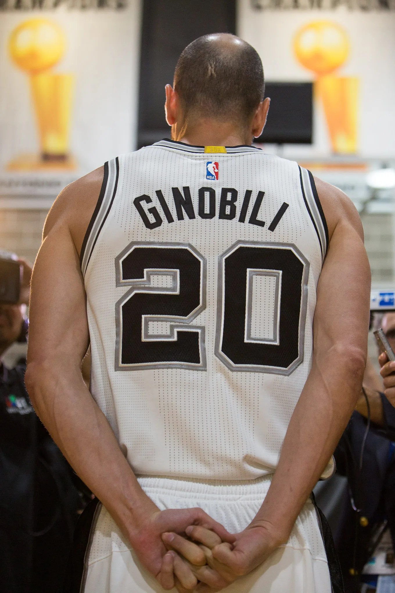 Spurs Guard Manu Ginobili stands for an interview in front of championship banners at the Spurs Practice Facility. Photo by Scott Ball.