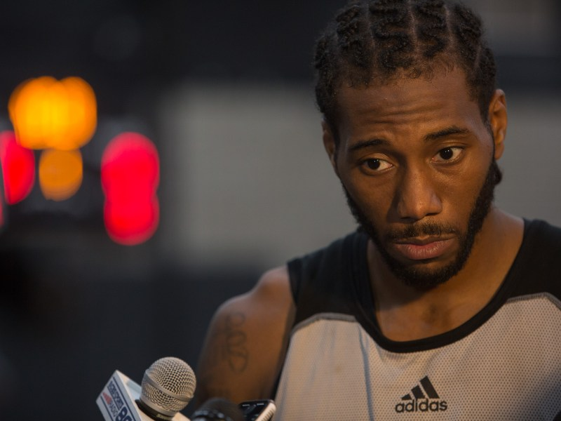 San Antonio Spurs Forward Kawhi Leonard responds to reporters question during the first day of practice on Tuesday September 27, 2016. Photo by Scott Ball.