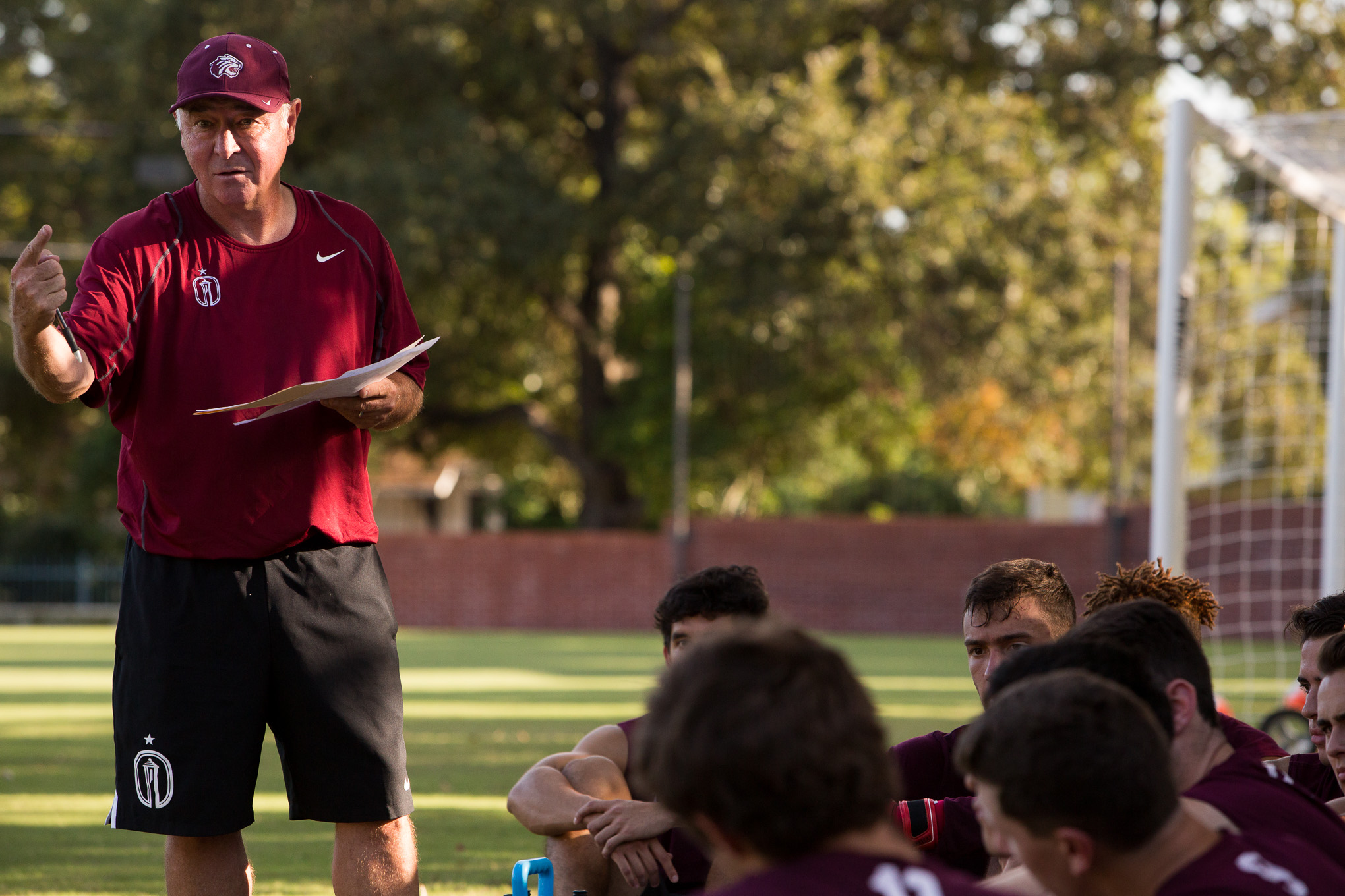 Trinity Men's Soccer Coach Paul McGinlay discusses last weeks game to his team. Photo by Scott Ball.