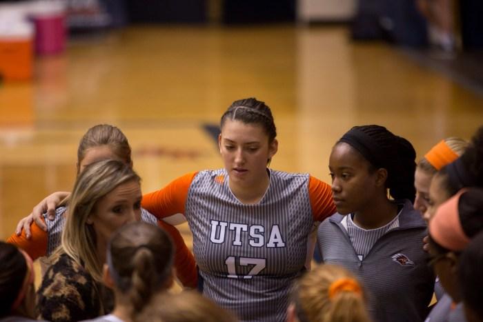 UTSA Outside Hitter Dajana Boskovic huddles with her team. Photo by Scott Ball.