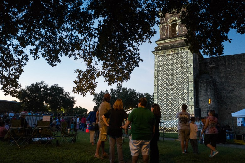 Attendees gather around illuminated sections of Mission San José. Photo by Scott Ball.
