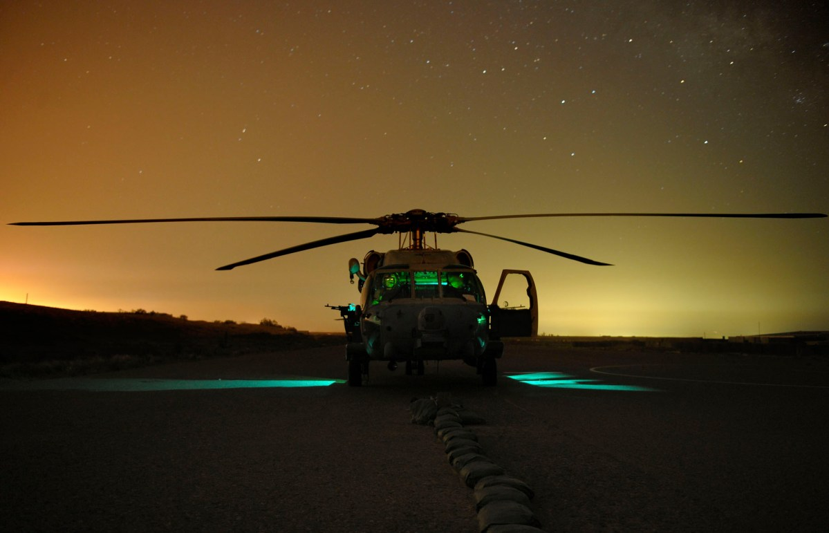 A Navy Sea Hawk helicopter lands outside Bayji, Iraq during an operation against Al-Qaeda. Photo by Mass Communication Specialist 2nd Class Miguel Angel Contreras for the U.S. Navy.