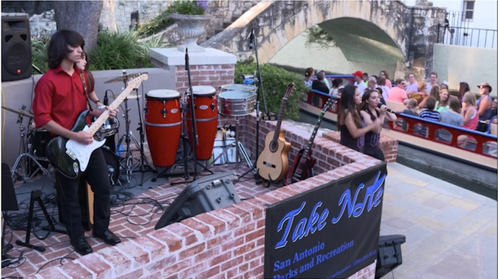 Video still of Take Note Youth Band performing at the Arneson River Theatre.
