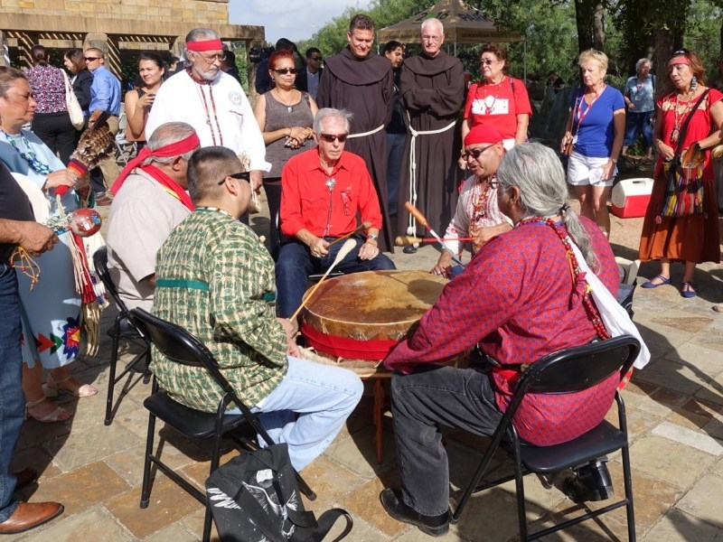 Mission descendants play a ceremonial drum at the kick-off for the inaugural World Heritage Festival. Photo by Robert Rivard.