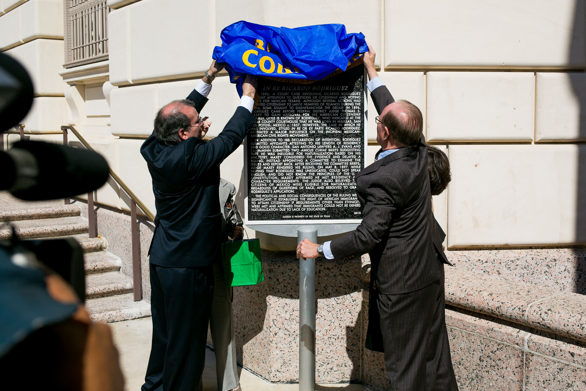 From left: The Honorable Xavier Rodriguez , Bexar County Judge Nelson Wolff , and U.S. General Services Administration's Regional Administrator Sylvia Hernandez unveil the historic marker. Photo by Kathryn Boyd-Batstone.