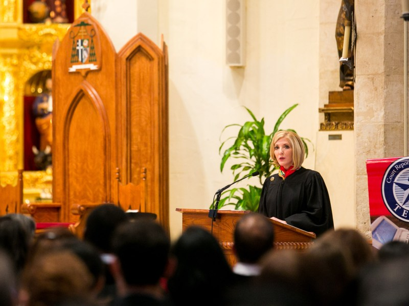 Fourth Court of Appeals Chief Justice Sandee Bryan Marion makes the judicial welcome remarks at Red Mass. Photo by Kathryn Boyd-Batstone.