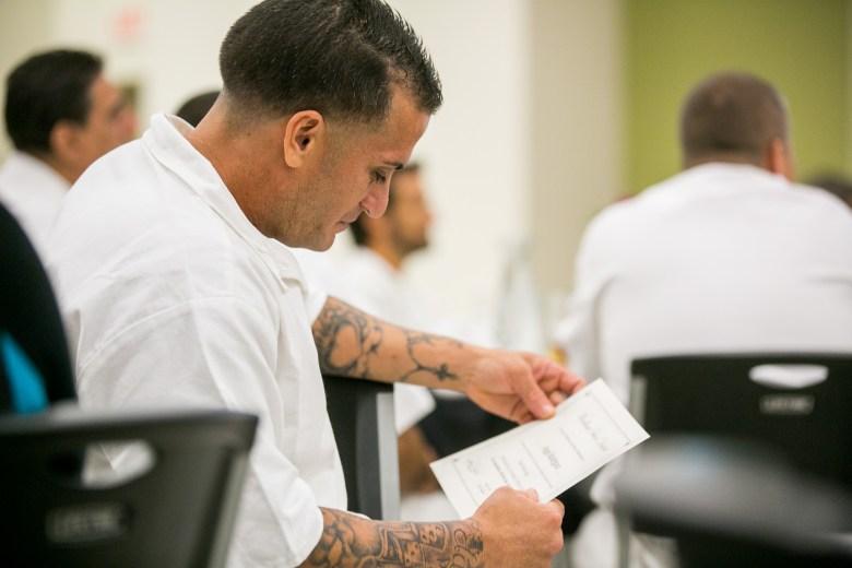 Angel Rodriguez re-reads his graduation certificate. Photo by Kathryn Boyd-Batstone.