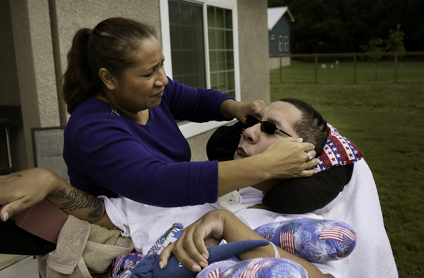 """If you want him to do something, talk to him like a regular person and then give him time because his brain doesn't function the same way as yours or mine,"""" Sonia Alvarado said. """"Now his brain is taking a few minutes to process the command and come up with a response for the command."""" Photo by Kathryn Boyd-Batstone."""