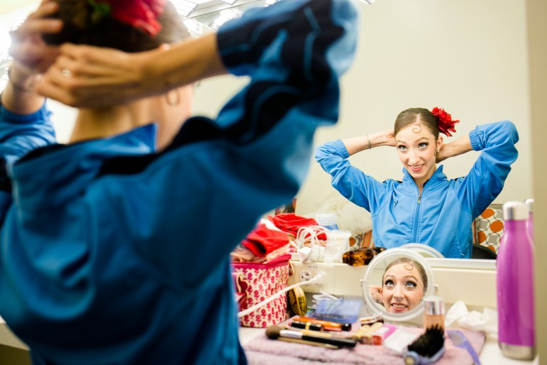 With the many costume and hair piece changes, Sally Turkel has to make sure her hair stays in place.