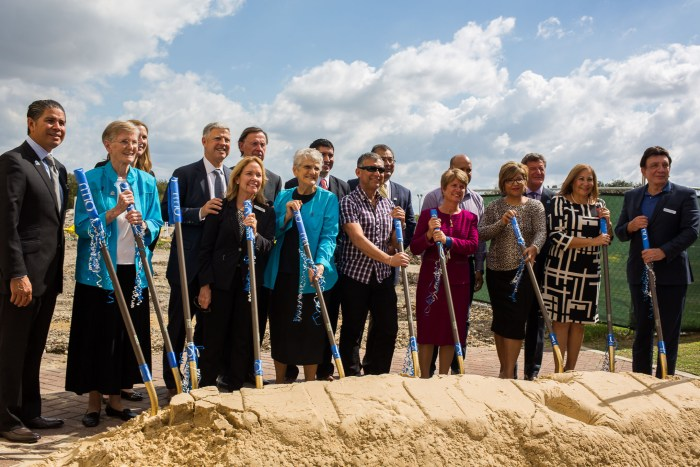 Faculty and administrators of Our Lake of the Lake University stand in front of where the 234-bed Residence Hall will be.
