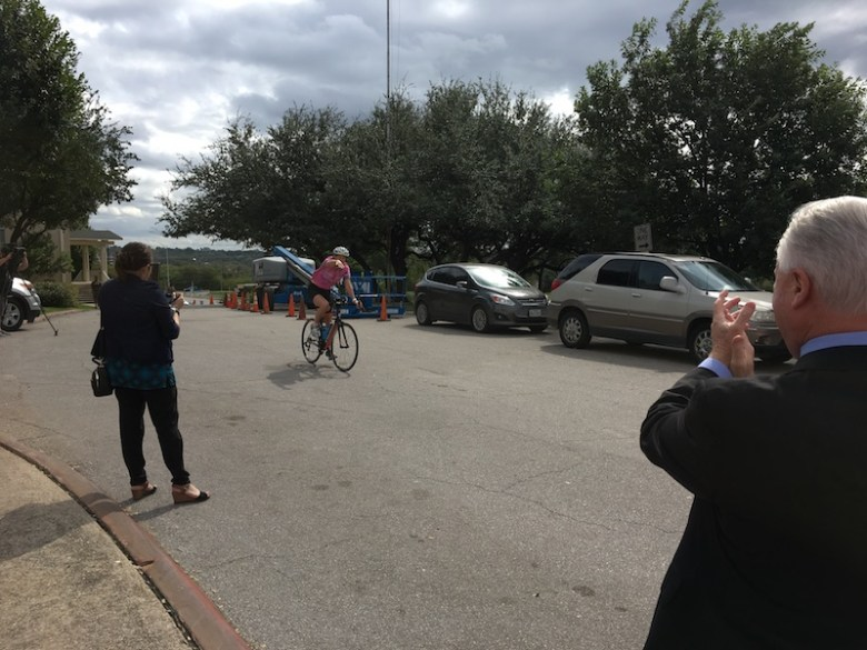 April Fricke cheers along the home stretch of her 250 mile ride to raise money and awareness for breast cancer screening.