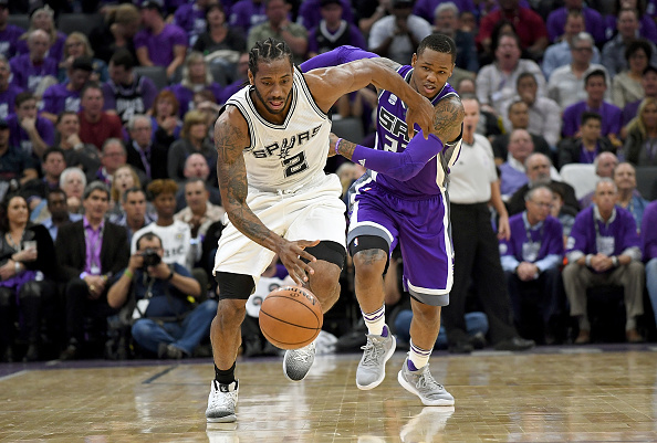 Kawhi Leonard #2 of the San Antonio Spurs steals the ball and breaks away from Ben McLemore #23 of the Sacramento Kings during the third quarter of an NBA basketball game at Golden 1 Center on October 27, 2016 in Sacramento, California.