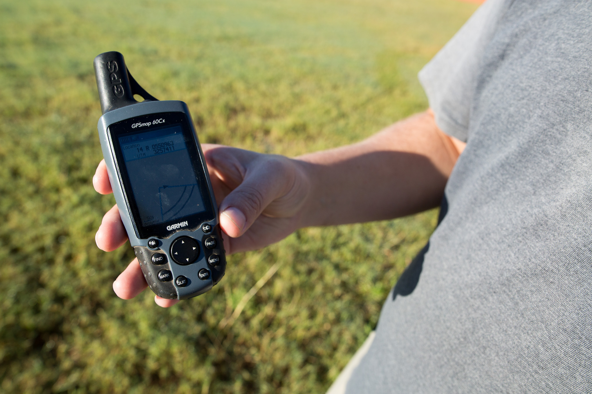 A handheld GPS unit is held by Project Archaeologist Mark Luzmoor to help determine the initial dig location.