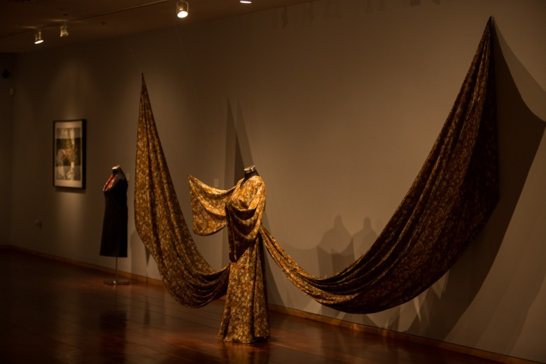 An elaborate dress crafted by designer Pineda Covalin features a wing-like cape at Instituto Cultural de México.