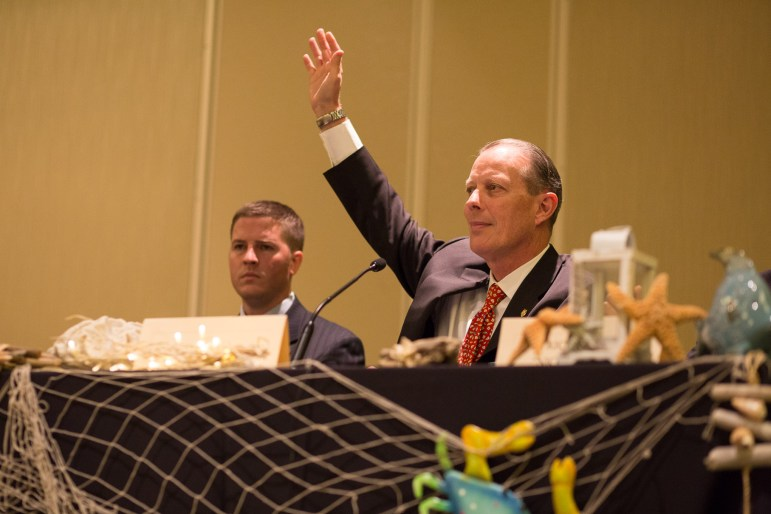 Director of the National Sheriff's Association Jonathan Thompson raises his hand after he asked attendees if they have had to deal with mental illness during some point in their career. Photo by Scott Ball.